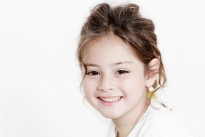 Smiling Girl with Healthy Teeth