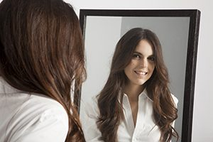 Woman's Smile in Mirror